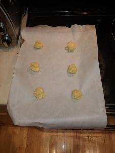 Gluten Free White Chocolate Macadamia Nut Cookie Dough on cookie sheet